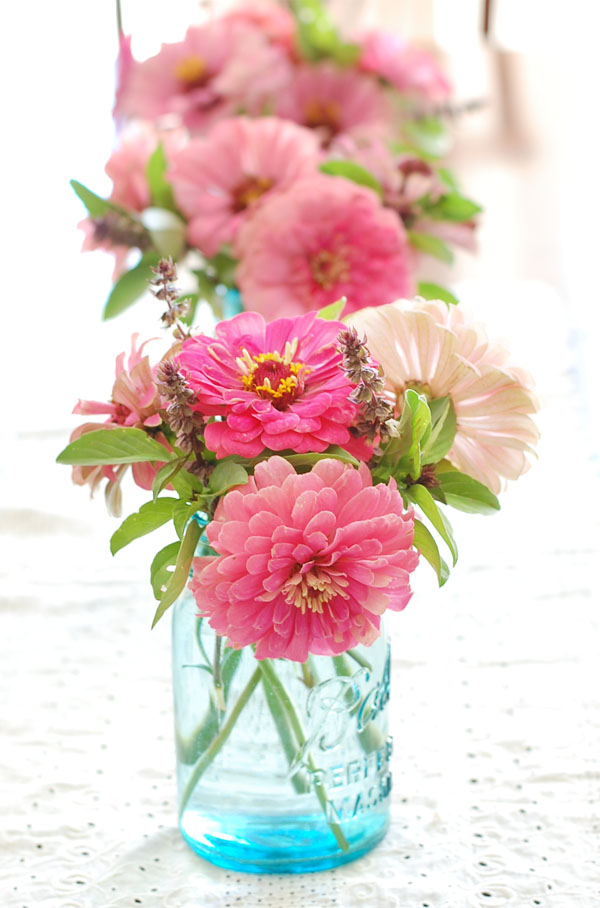 Zinnias and Basil in Blue Bal Jars The Prudent Homemaker