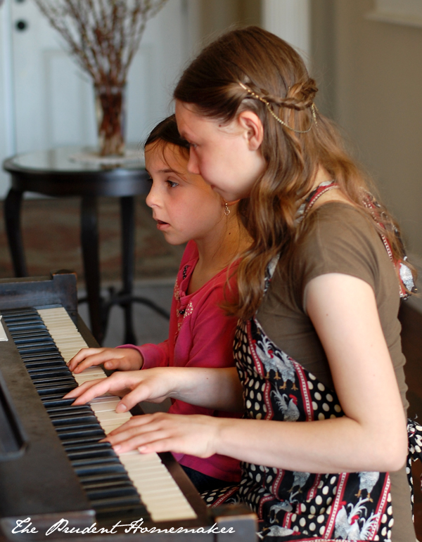 Libby and Winter at the piano The Prudent Homemaker